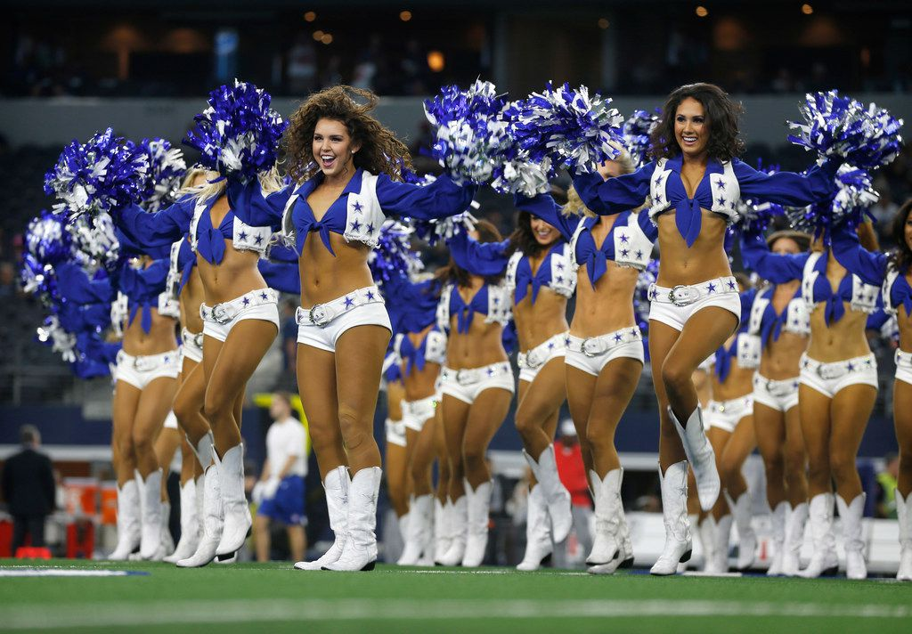 Dallas Cowboys Cheerleaders perform during the preseason game against the Tampa Bay Buccaneers at AT&T Stadium in Arlington.