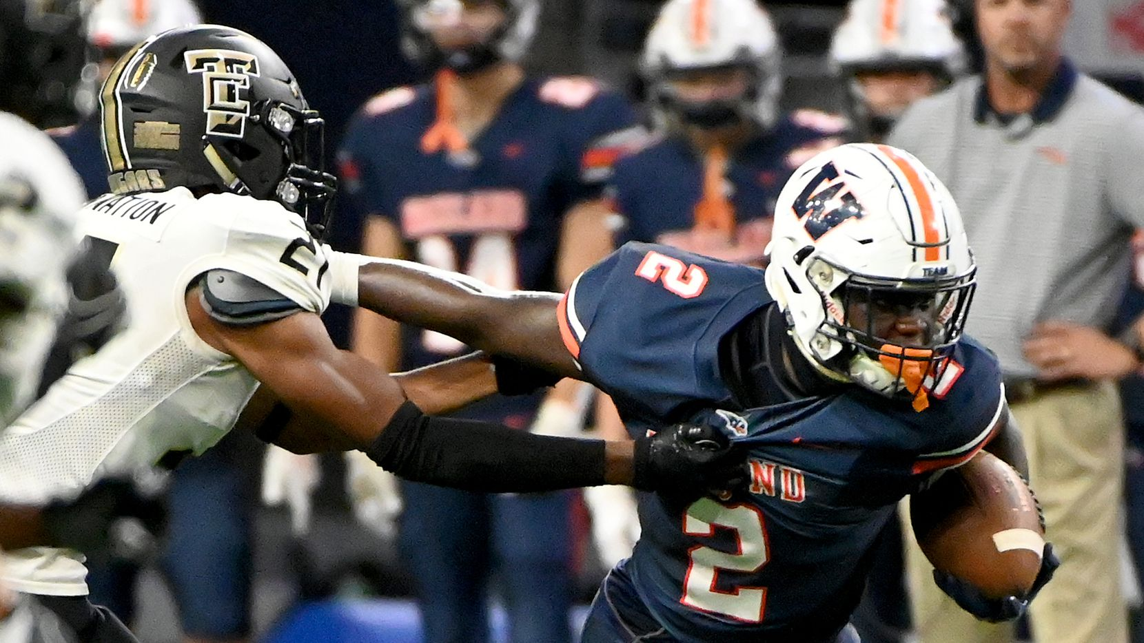 Frisco Wakeland's Jared White (2) runs through a tackle attempt by The Colony's Aaron Trotter (21) in the first half of a high school football game between The Colony and Frisco Wakeland, Friday, Sept. 17, 2021, in Frisco, Texas.