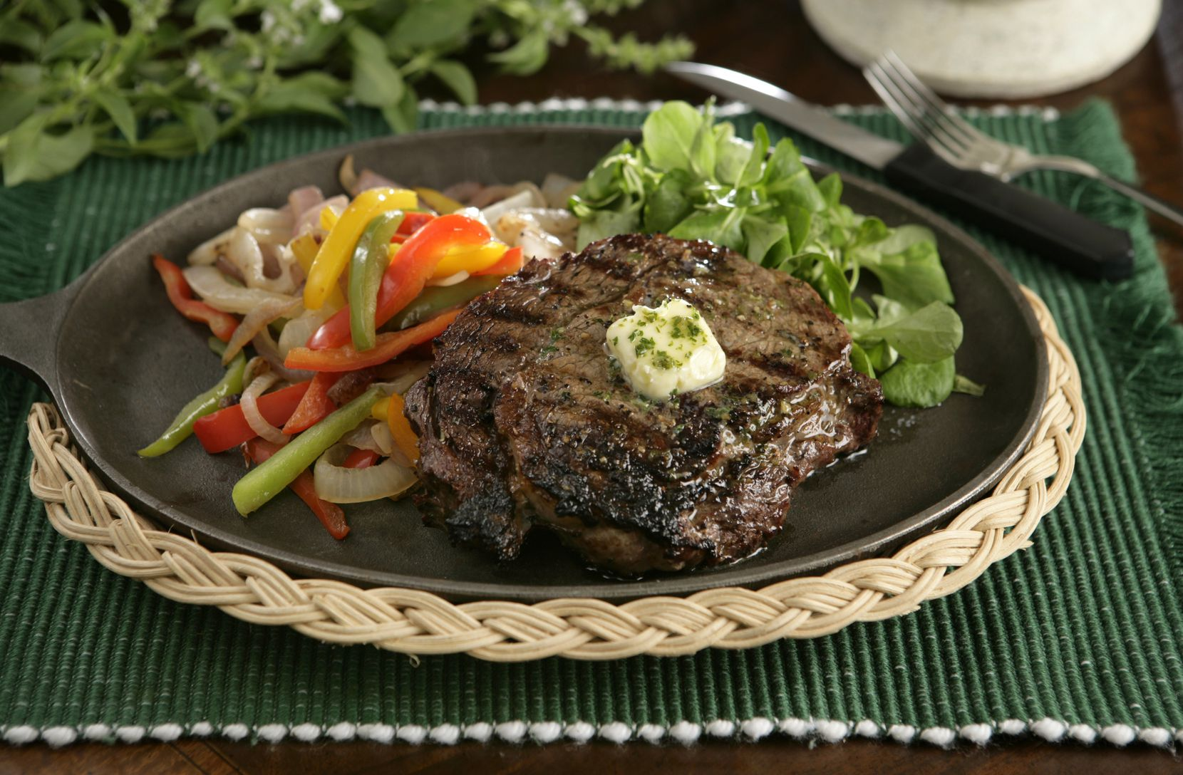A beautifully grilled ribeye steak.