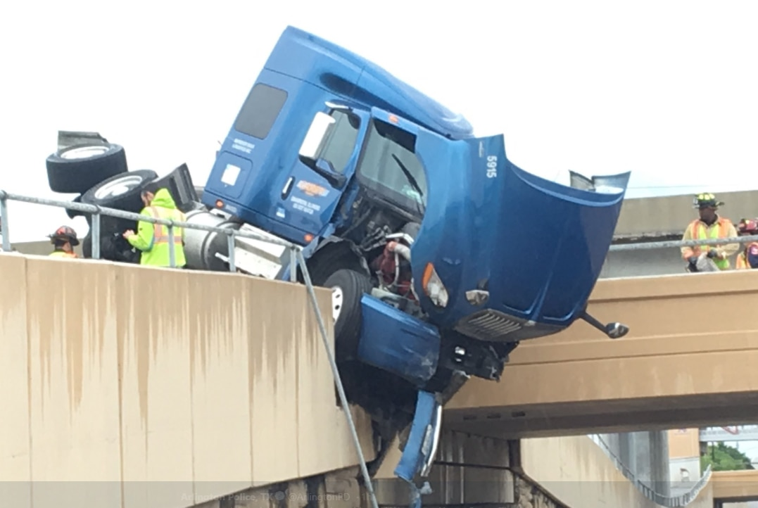 A tractor-trailer crashed in Arlington, and the semi was left dangling over Abram Street.