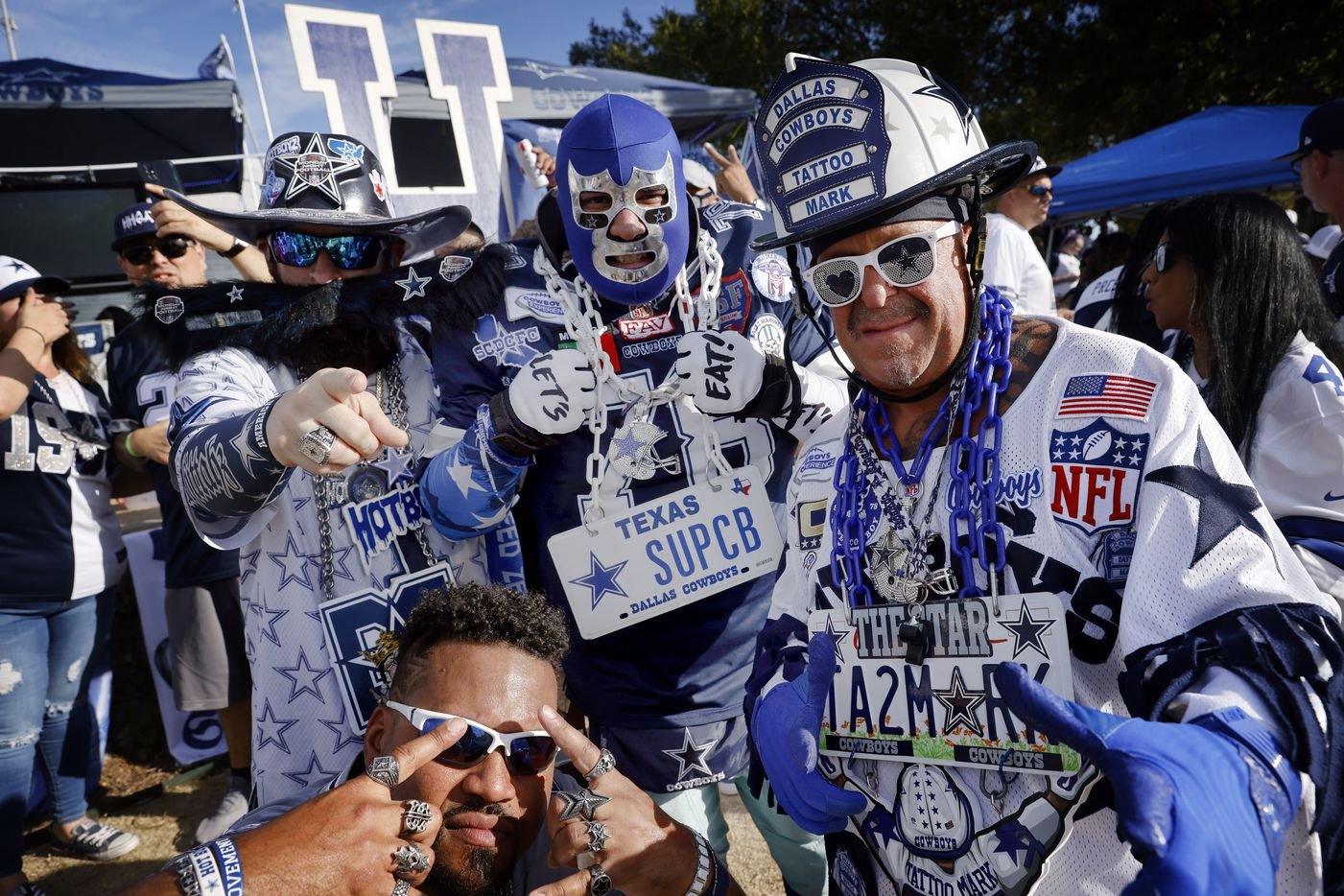 Dallas Cowboys super fans pose for a photo at a tailgate party before the Monday Night Football game at AT&T Stadium in Arlington, Monday, September 27, 2021. (Tom Fox/The Dallas Morning News)