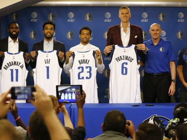 Dallas Mavericks team president and general manager Donnie Nelson, Dallas Mavericks guard Tim Hardaway Jr. (11), Dallas Mavericks guard Courtney Lee (1), Dallas Mavericks guard Trey Burke (23), Dallas Mavericks forward Kristaps Porzingis (6), Dallas Mavericks head coach Rick Carlisle and Dallas Mavericks owner Mark Cuban pose for the media during a press conference announcing the new players added to the team at American Airlines Center in Dallas on Monday, February 4, 2019.