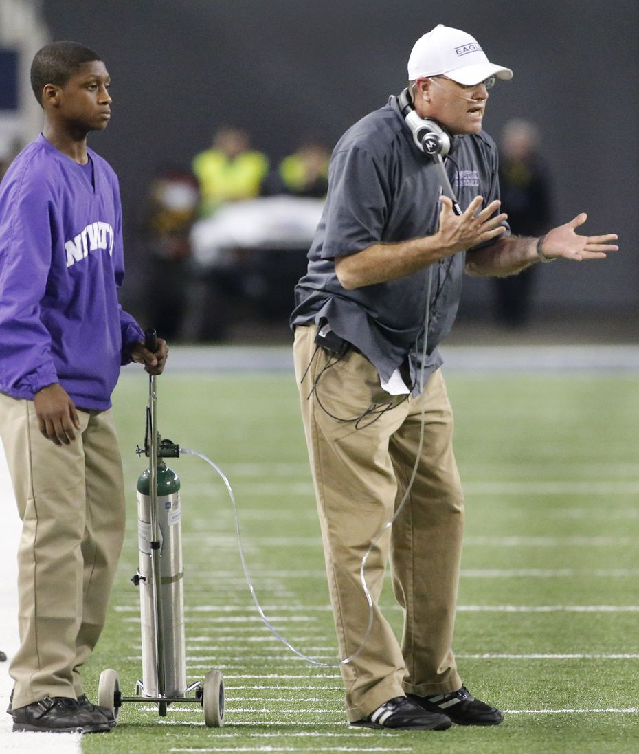 Newton head coach WT Johnston works the sidelines, aided by an oxygen tank to help his ailing lungs, during the 3A-2 state championship game between Waskom High School Wildcats and the Newton High School Eagles at AT&T Stadium in Arlington on Thursday, December 18, 2014.  (Louis DeLuca/The Dallas Morning News)