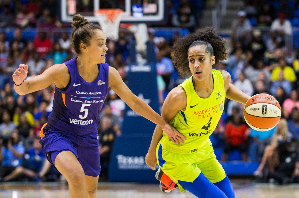 Dallas Wings guard Skylar Diggins-Smith (4) gets around Phoenix Mercury guard Leilani Mitchell (5) during the first quarter of a WNBA game between the Dallas Wings and the Phoenix Mercury on Tuesday, July 10, 2018 at College Park Center in Arlington, Texas.