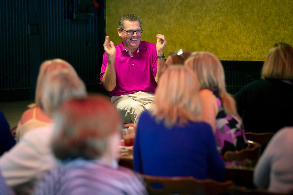 """Fathom Realty vice president JR Russell applauds a presentation by attorney K. Annette Disch during what the company calls a  """"HAPPY/ Class"""" at  Sherlocks Baker Street Pub. (Smiley N. Pool/The Dallas Morning News)"""