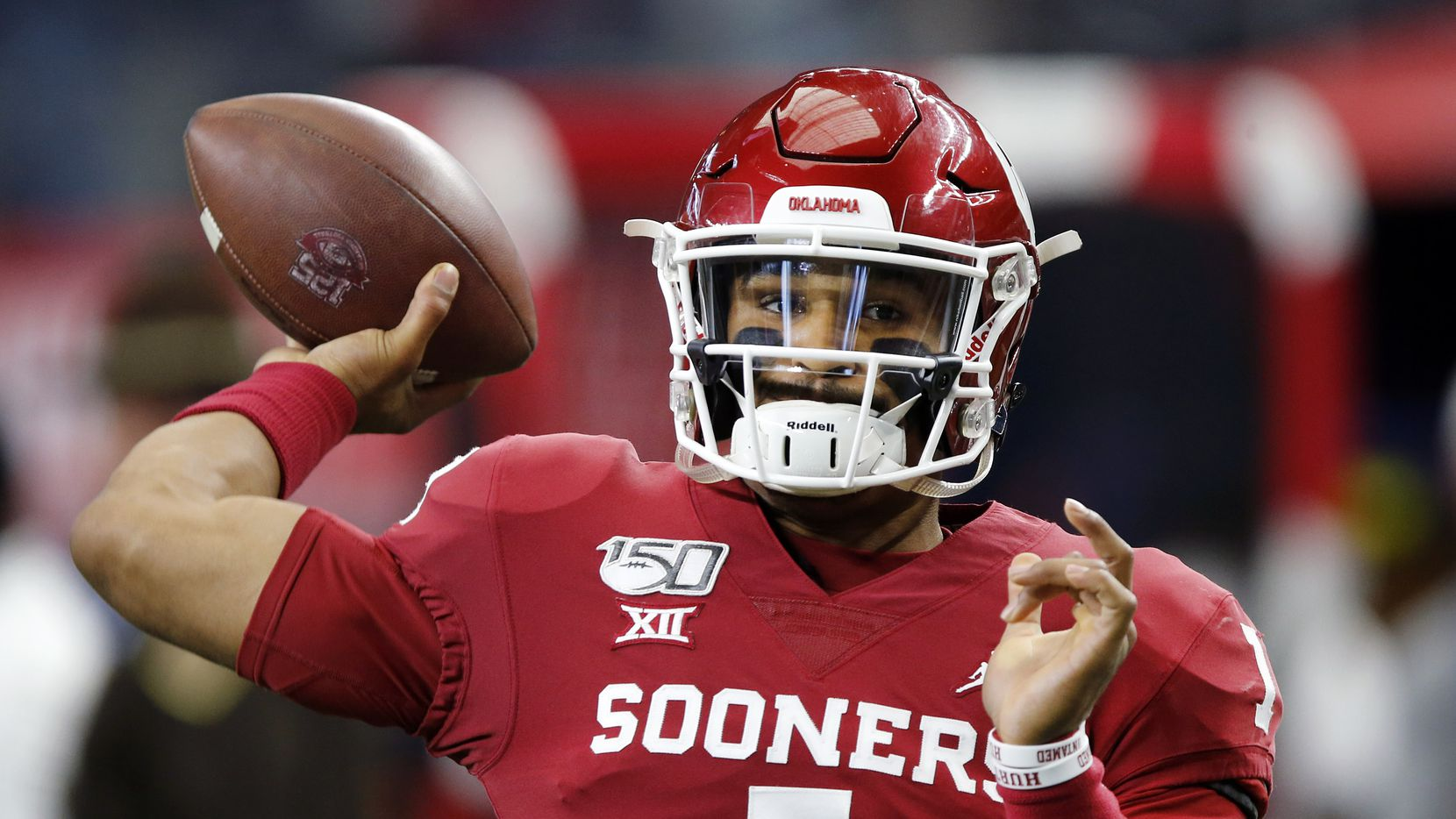 Oklahoma Sooners quarterback Jalen Hurts (1)  warms up his arm before facing the Baylor Bears in the Big 12 Championship at AT&T Stadium in Arlington, Saturday, December 7, 2019.