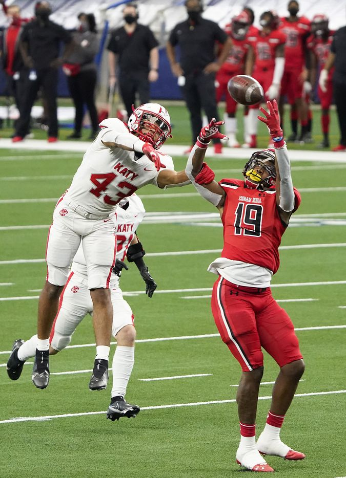Katy defensive back Dalton Johnson (43) breaks up a pass intended for Cedar Hill wide receiver Earnie Moore (19) during the first half of the Class 6A Division II state football championship game at AT&T Stadium on Saturday, Jan. 16, 2021, in Arlington, Texas.