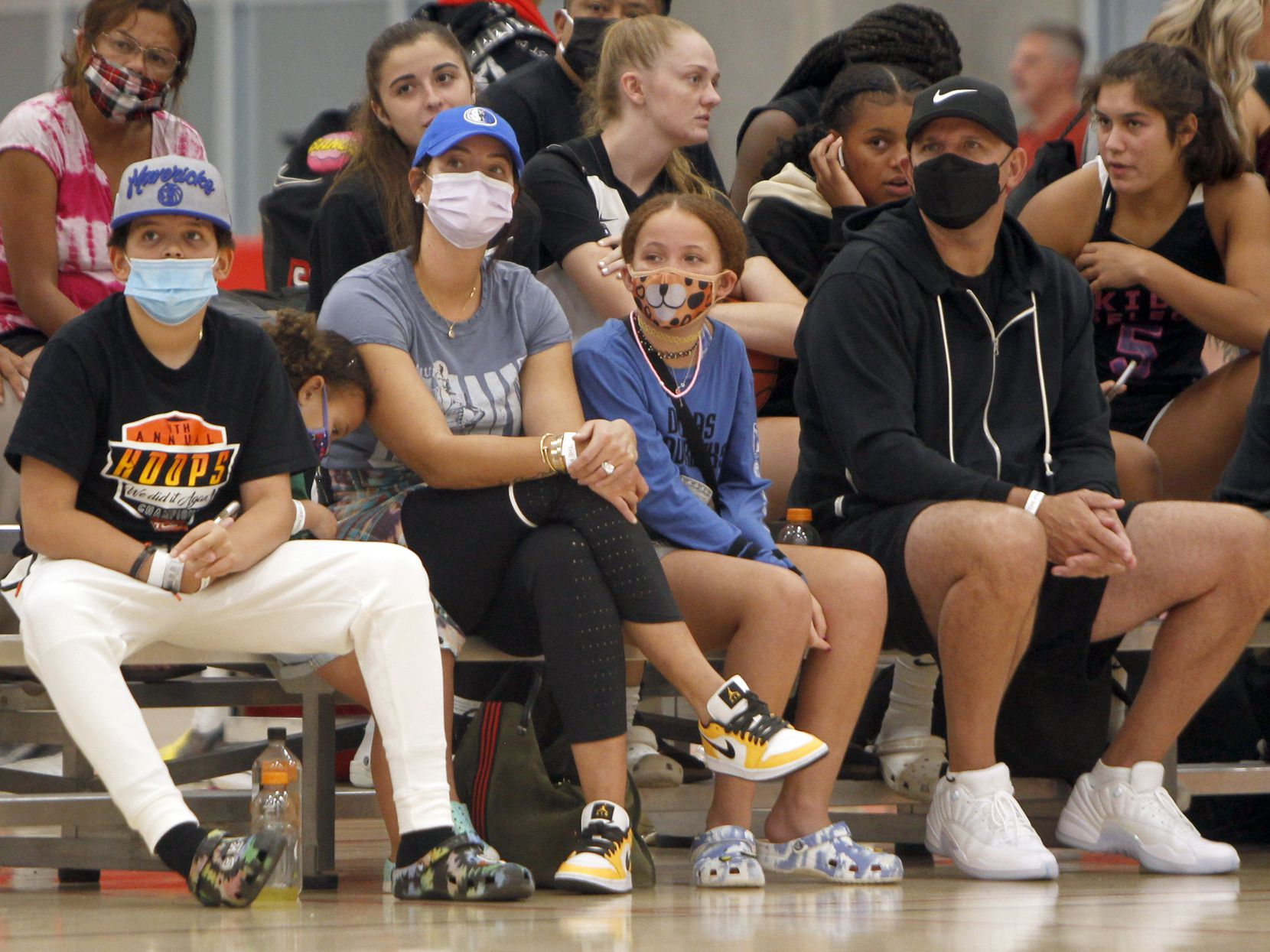 Dallas Mavericks head coach Jason Kidd, right,  watches alongside his family in attendance for a girls basketball game featuring Kidd Select, a team he sponsors. Family members from left are, Noah, 9, Cooper,3, wife Porschla and Chance,11.  The tournament was held at Fieldhouse USA in Mansfield on August 21, 2021. (Steve Hamm/ Special Contributor)