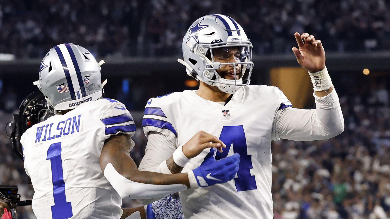 Dallas Cowboys quarterback Dak Prescott (4) congratulates wide receiver Ced Wilson (1) after his fourth quarter touchdown at AT&T Stadium in Arlington, Monday, September 27, 2021.