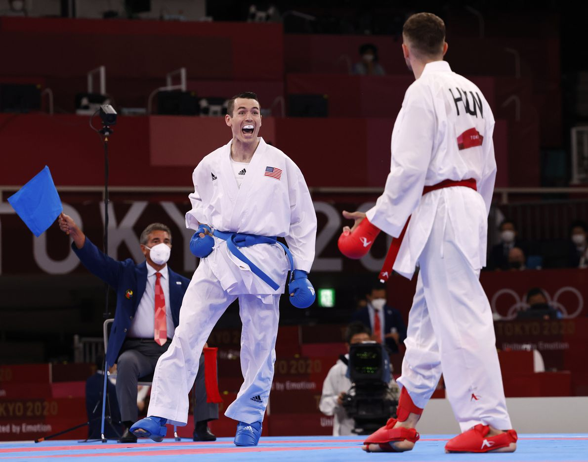 USA's Tom Scott celebrates after kicking Hungary's Karoly Gabor Harspataki in the head during the karate men's kumite -75kg elimination round at the postponed 2020 Tokyo Olympics at Nippon Budokan, on Friday, August 6, 2021, in Tokyo, Japan. Scott defeated Harspataki 8-3. Scott finished in fourth place in his pool and did not advance to the next round. (Vernon Bryant/The Dallas Morning News)
