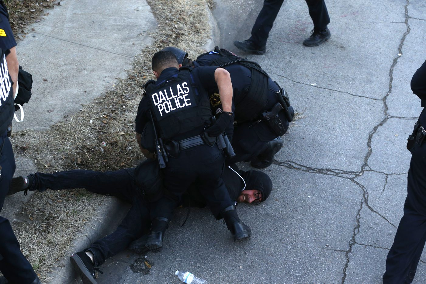 A protester is arrested during the J20 Dallas Anti Trump March & General Strike on Bishop st. in Dallas on January 20, 2017.
