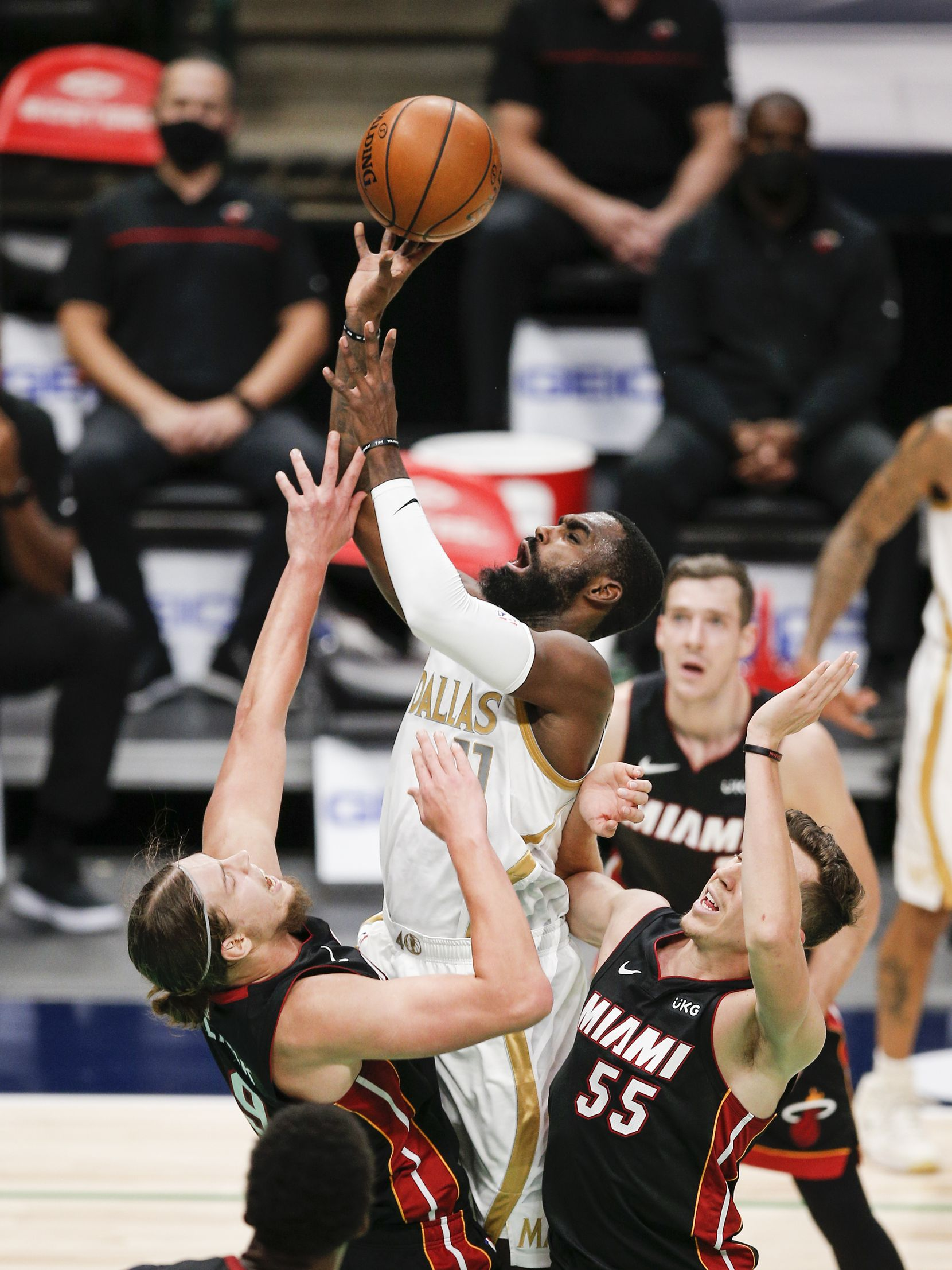 Dallas Mavericks guard Tim Hardaway Jr. (11) attempts a shot as Miami Heat forwards Kelly Olynyk (9) and Duncan Robinson (55) defend during the second half of an NBA basketball game, Friday, January 1, 2021.  Dallas won 93-83. (Brandon Wade/Special Contributor)