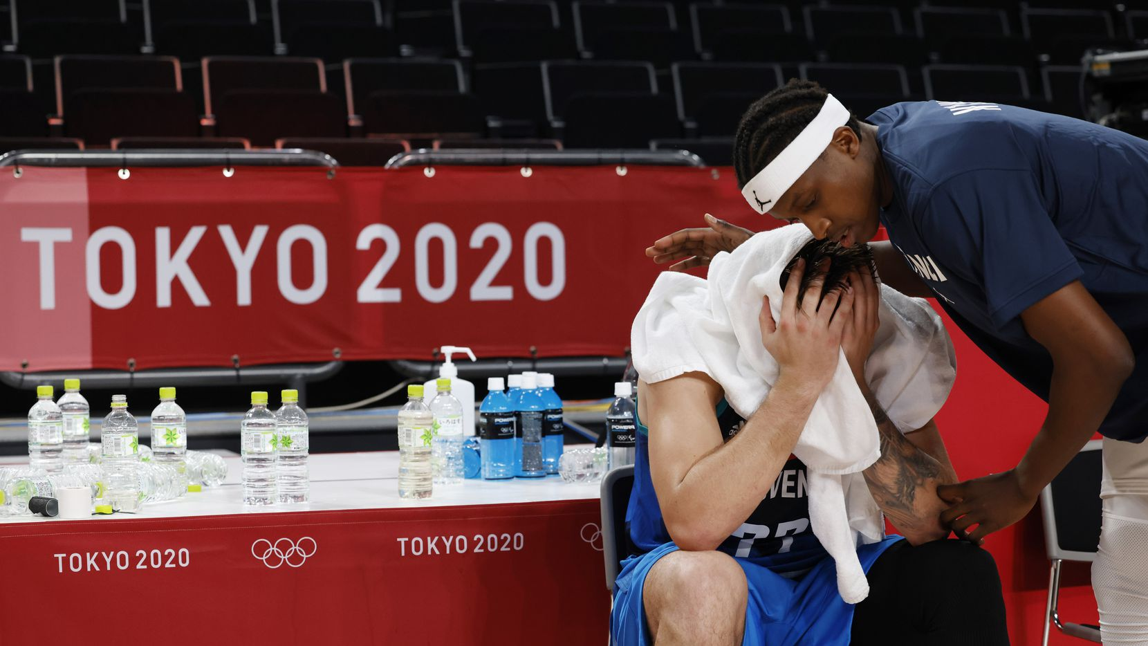 Slovenia's Luka Doncic (77) sits dejected as France's Frank Ntilikina (1) speaks to him after losing to France 90-89 in a men's basketball semifinal at the postponed 2020 Tokyo Olympics at Saitama Super Arena, on Thursday, August 5, 2021, in Saitama, Japan. France defeated Slovenia 90-89. Slovenia will play in the bronze medal game.