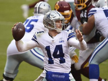 Cowboys quarterback Andy Dalton (14) looks to pass against the Washington Football Team in the third quarter of the game at FedExField on Oct. 25, 2020 in Landover, Md. (Photo by Patrick McDermott/Getty Images)