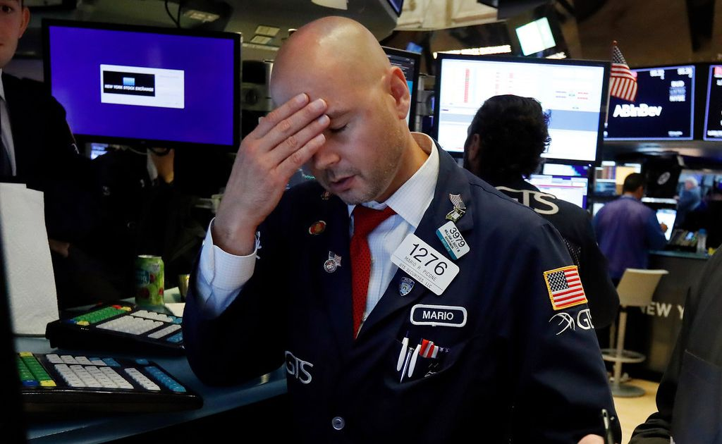 Dow falls 800 points in its biggest decline of the year, reacting to bad news at home and abroad
