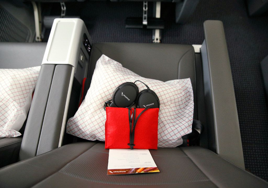 Headphones with a blanket and pillow offered in the new premium economy cabin seating in the American Airlines new 787-9 Dreamliner at DFW Airport on Nov. 3, 2016.  (Nathan Hunsinger/The Dallas Morning News)