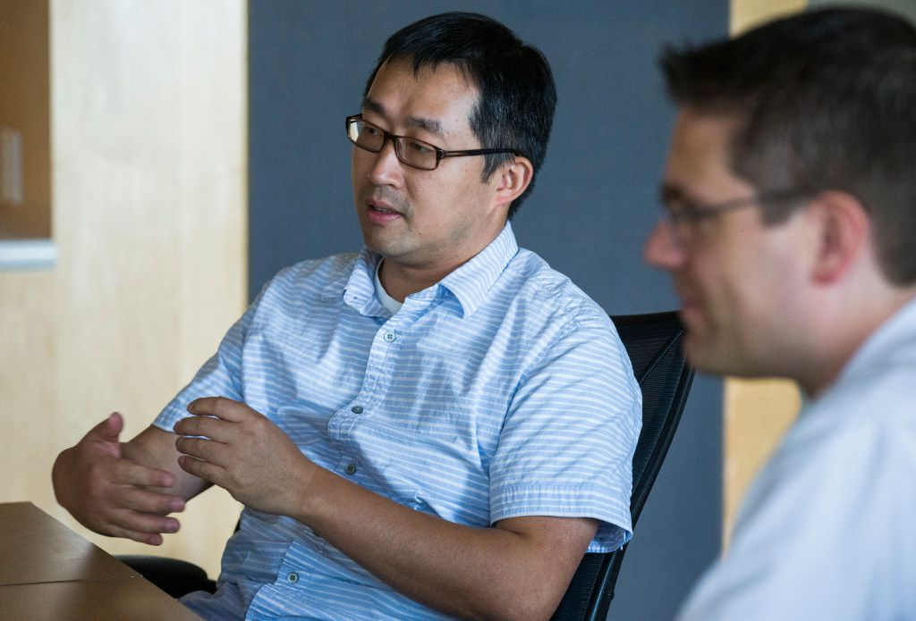 UT-Arlington associate professor of computer science and engineering Chengkai Li (left) and associate professor of computer science and engineering Christoph Csallner talk about how to identify fake news.