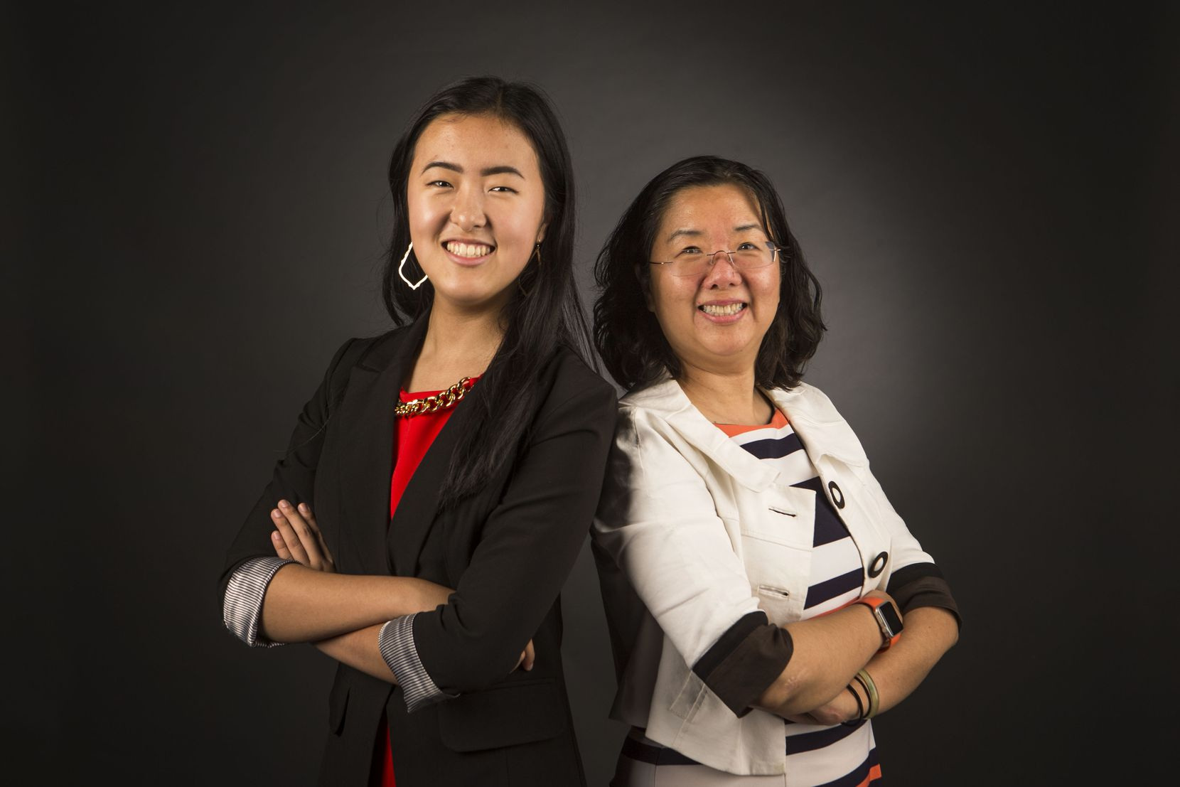 Alice Hou, founder of Girls in STEM, left, and her mom, Sara He, pose for a photograph at The Dallas Morning News on July 24, 2018. (Carly Geraci/The Dallas Morning News)