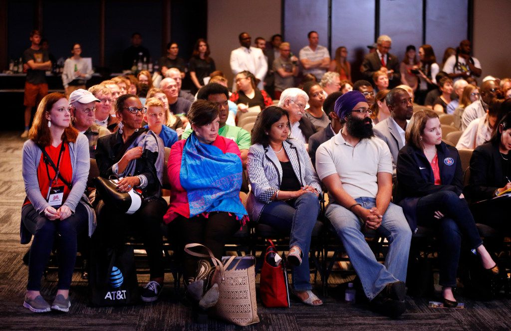 Audience members listen to Potter's House pastor T.D. Jakes and AT&T CEO Randall L. Stephenson close out the Dallas Festival of Ideas on Saturday at the Kay Bailey Hutchison Convention Center. (Tom Fox/The Dallas Morning News)