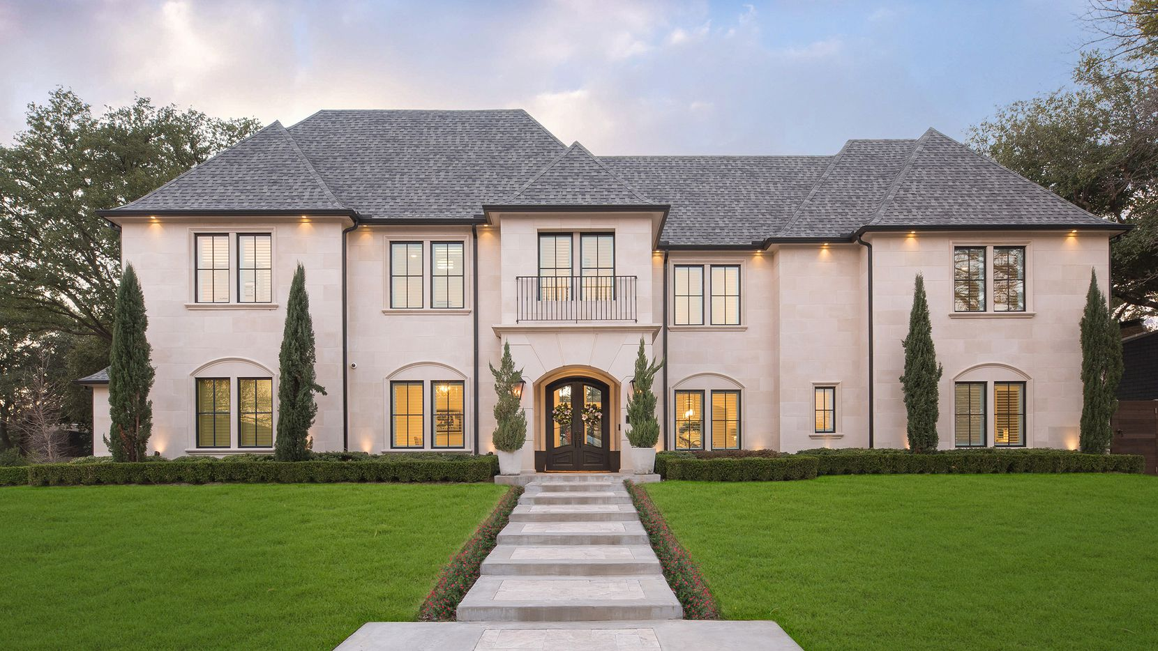 The 7,809-square-foot residence at 7233 Lupton Circle features six bedrooms and a contemporary style.