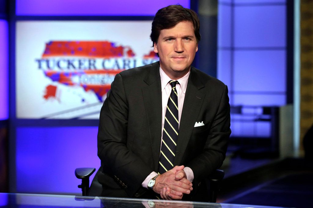 "In this March 2, 2017, file photo, Tucker Carlson, host of ""Tucker Carlson Tonight,"" poses for photos in a Fox News Channel studio in New York."