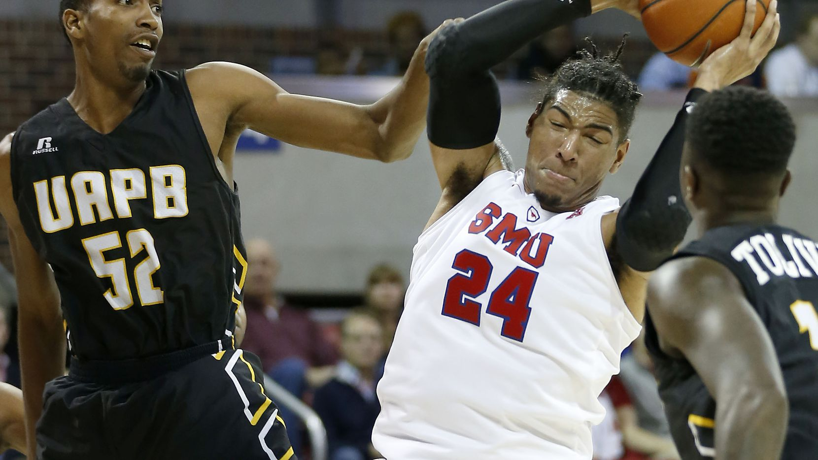 FILE - SMU forward Everett Ray (24) gets a rebound against Arkansas-Pine Bluff center David Tillman (52) during the first half at Moody Coliseum in Dallas, Saturday, Nov. 18, 2017. (Jae S. Lee/The Dallas Morning News)