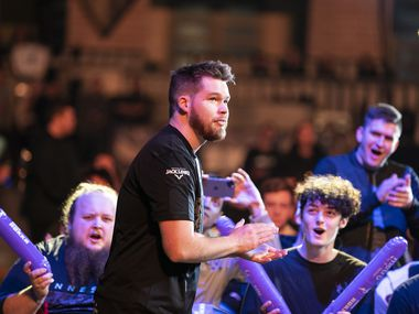 """FILE - Fans cheer for Ian """"Crimsix"""" Porter as he takes the stage before Dallas Empire competes against Chicago Huntsmen in the Call of Duty League Launch Weekend at the Armory in Minneapolis on Jan. 24, 2020."""