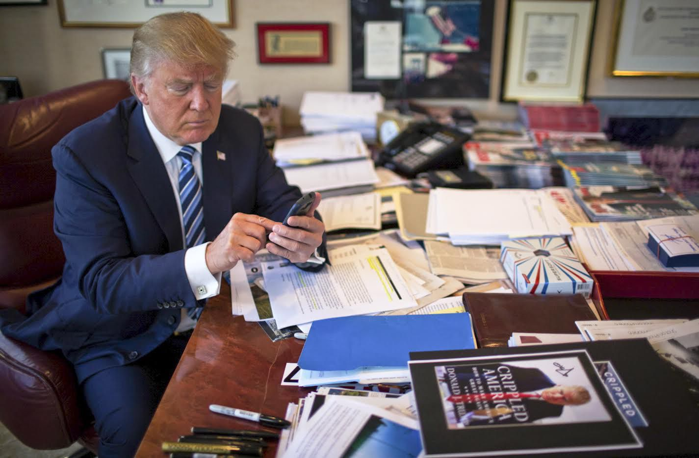 FILE-- Donald Trump demonstrates his tweeting skills in his office at Trump Tower in New York, Sept. 29, 2015. China's leaders thought they had a solution to the torrent of snark, jibes and condemnation on Twitter: They banned access to it at home. Yet in a twist, China has become the country that the now President-elect seems to enjoy criticizing the most on his open-all-hours Twitter feed. (Josh Haner/The New York Times)