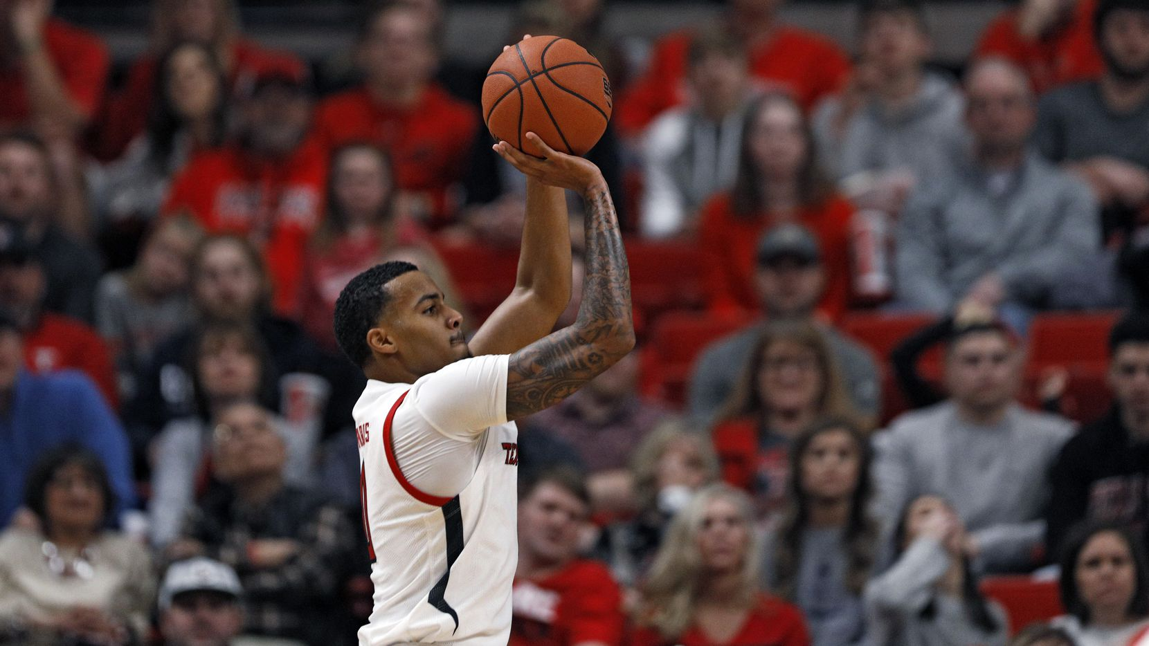 Texas Tech's Kyler Edwards (0) shoots for three points during the second half of an NCAA college basketball game against Cal State Bakersfield, Sunday, Dec. 29, 2019, in Lubbock, Texas.
