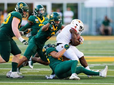 Iowa State Cyclones running back Johnnie Lang (4) is tackled by Baylor Bears linebacker Terrel Bernard (26), Baylor Bears linebacker Blake Lynch (2) and Baylor Bears defensive tackle James Lynch (93) during the second half of play at McLane Stadium in Waco, Texas on Saturday, September 28, 2019. Baylor Bears defeated Iowa State Cyclones 23-21.