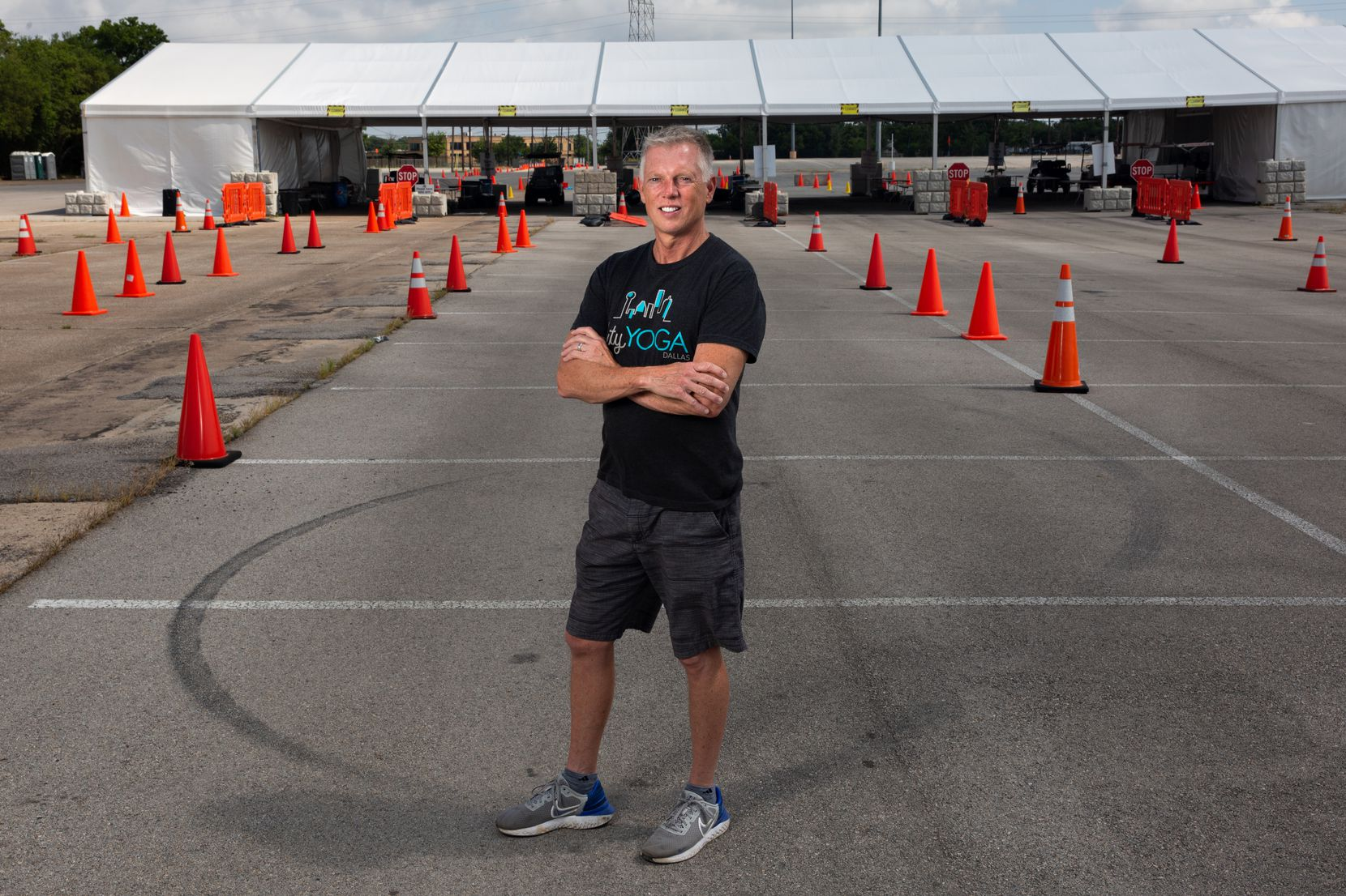 Mike Luckock volunteered at the Fair Park mega vaccination site nearly every day between January and April of 2021. The vaccination site is set to close this Saturday after months of successful inoculations. (Shelby Tauber/Special Contributor)