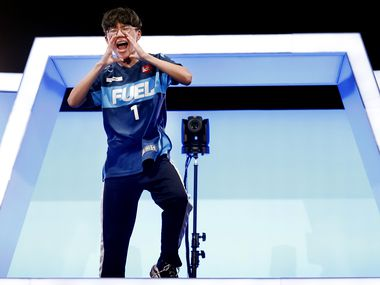 Dallas Fuel player Yeonghan 'Sp9rk1e' Kim acknowledges his fans that stuck around after their Overwatch League win against the Houston Outlaws at Esports Stadium Arlington Friday, July 9, 2021. Dallas Fuel defeated Houston in The Battle for Texas, 3-0. It was the first in-person live competition for fans in over a year. Houston competed from their hometown. (Tom Fox/The Dallas Morning News)