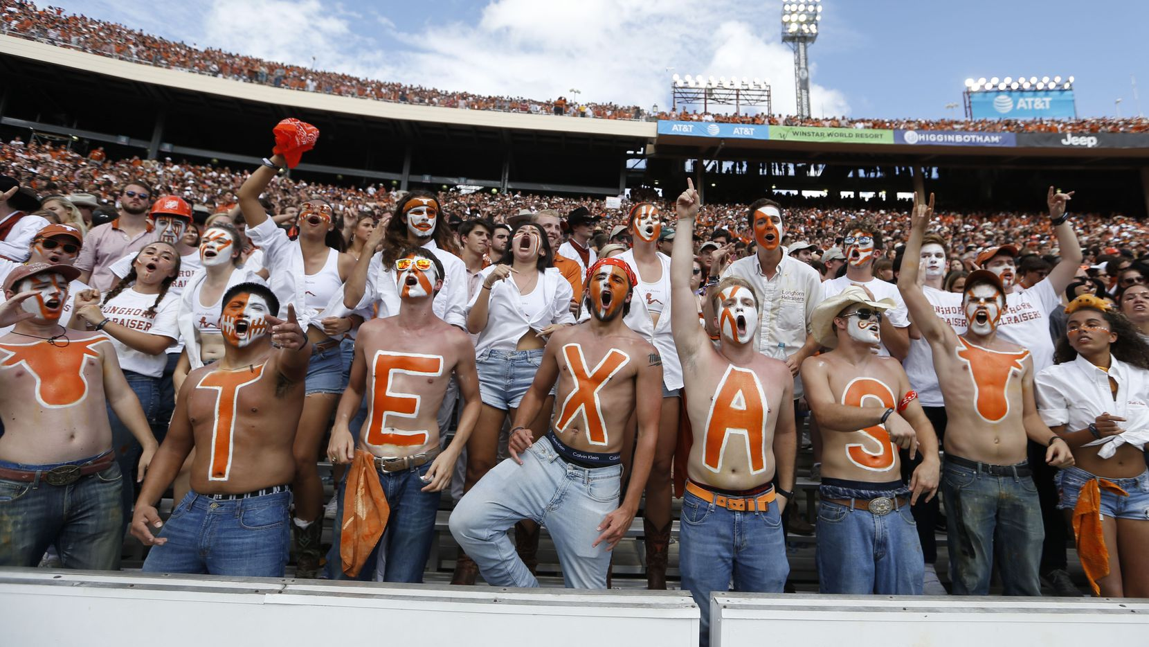 Texas Longhorns fans cheer for their team during the second half of play at the Cotton Bowl in Dallas on Saturday, October 6, 2018. Texas Longhorns defeated Oklahoma Sooners 48-45. (Vernon Bryant/The Dallas Morning News)