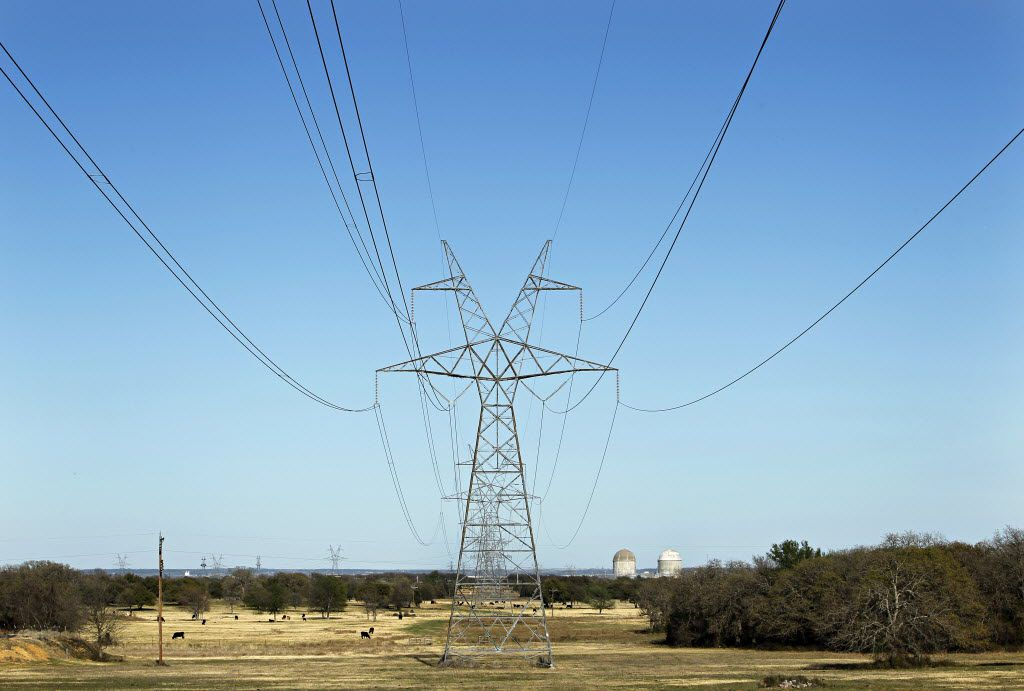 Electrical transmission lines lead to Luminant's Comanche Peak Nuclear Power Plant near Glen Rose, Texas, Wednesday, March 23, 2011. Reactor Units 1, right, and 2 can be seen at the plant. (Tom Fox/The Dallas Morning News)
