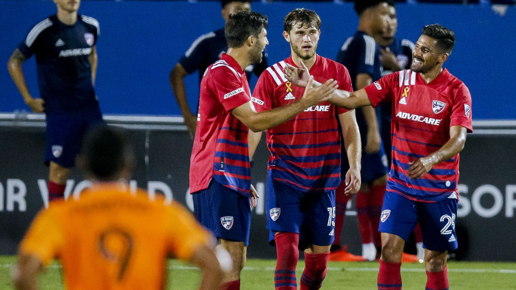 FC Dallas attacker Franco Jara , right, is congratulated by midfielder Ryan Hollingshead (12) after scoring a goal during the second half of an MLS soccer match against the Houston Dynamo at Toyota Stadium in Frisco, Saturday, September 12, 2020. FC Dallas won 2-1.