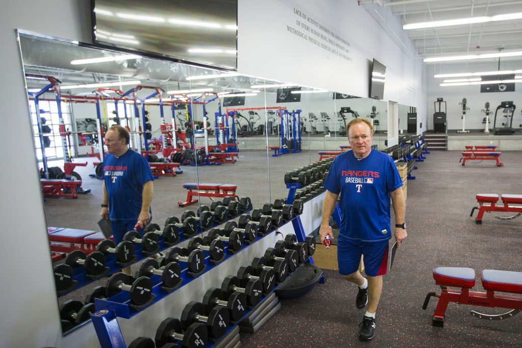 Texas Rangers strength and conditioning consultant Gene Coleman walks through the expanded weightroom at the Texas Rangers newly renovated spring training facility during a media tour on Thursday, Feb. 18, 2016, in Surprise, Ariz. (Smiley N. Pool/The Dallas Morning News)