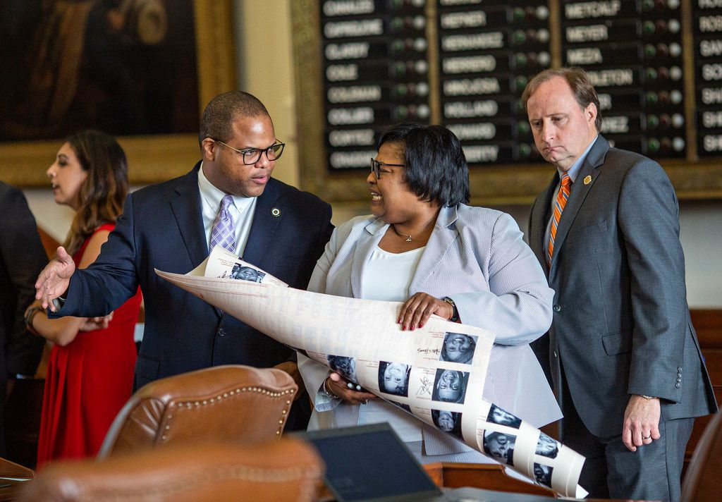 State Rep. Eric Johnson (left) chats with State Rep. Toni Rose on the House floor just before Sine Die at the State Capitol of Texas on May 27, 2019 in Austin, Texas.