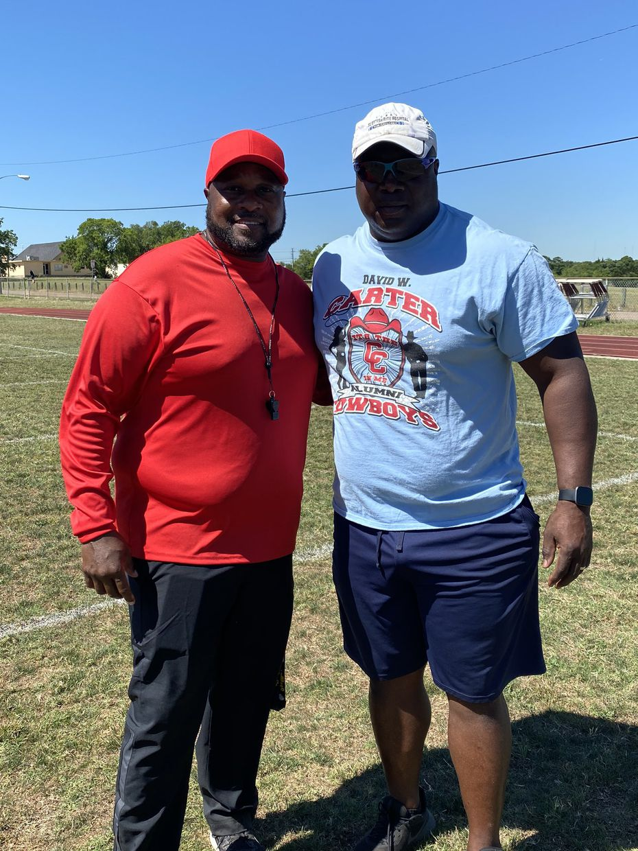 Former Carter football player Le Shai Maston (right), a police officer for Dallas County Community College, spoke to the Carter football team about racial issues and policing in today's society. Maston is pictured with Carter coach Spencer Gilbert.