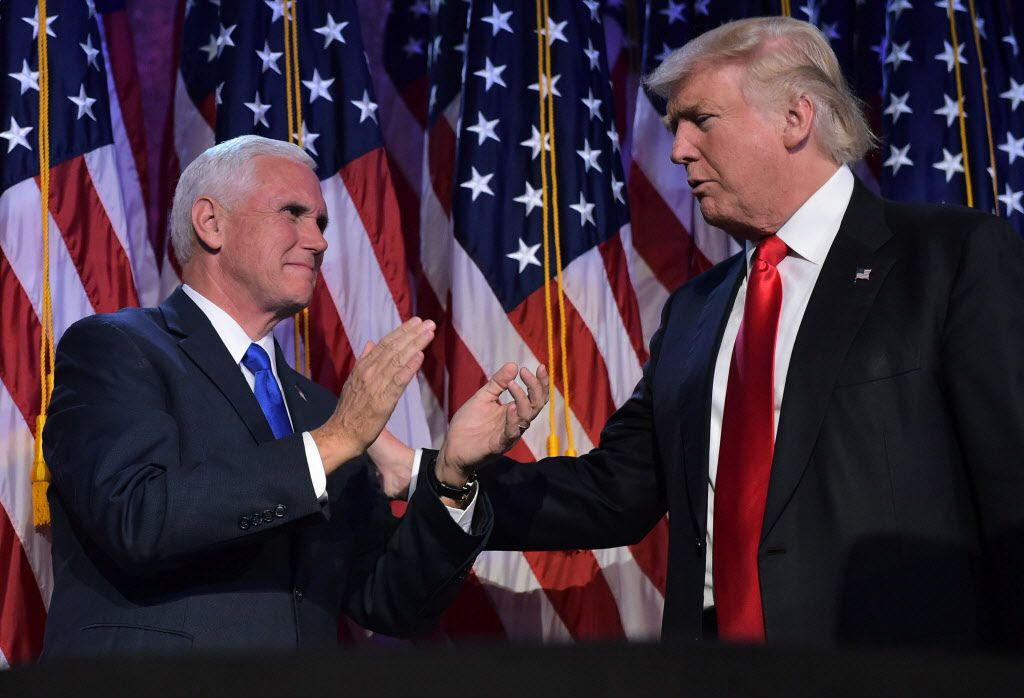 Donald Trump and his running mate Mike Pence celebrate on election night at the New York Hilton Midtown in New York.