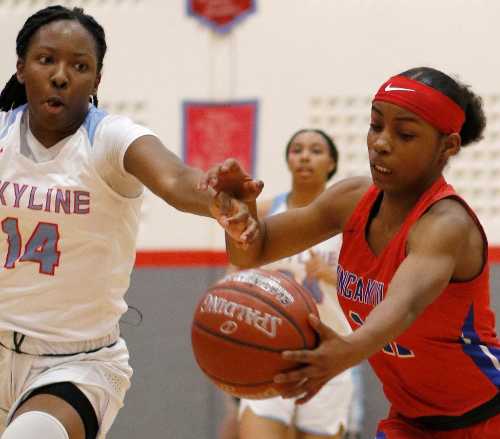 Duncanville's Tristen Taylor (11) battles Dallas Skyline's Daryn Batts (14) for ball possession during first half action. The two teams played their girls basketball game at  Skyline High School in Dallas on January 7, 2020. (Steve Hamm/ Special Contributor)