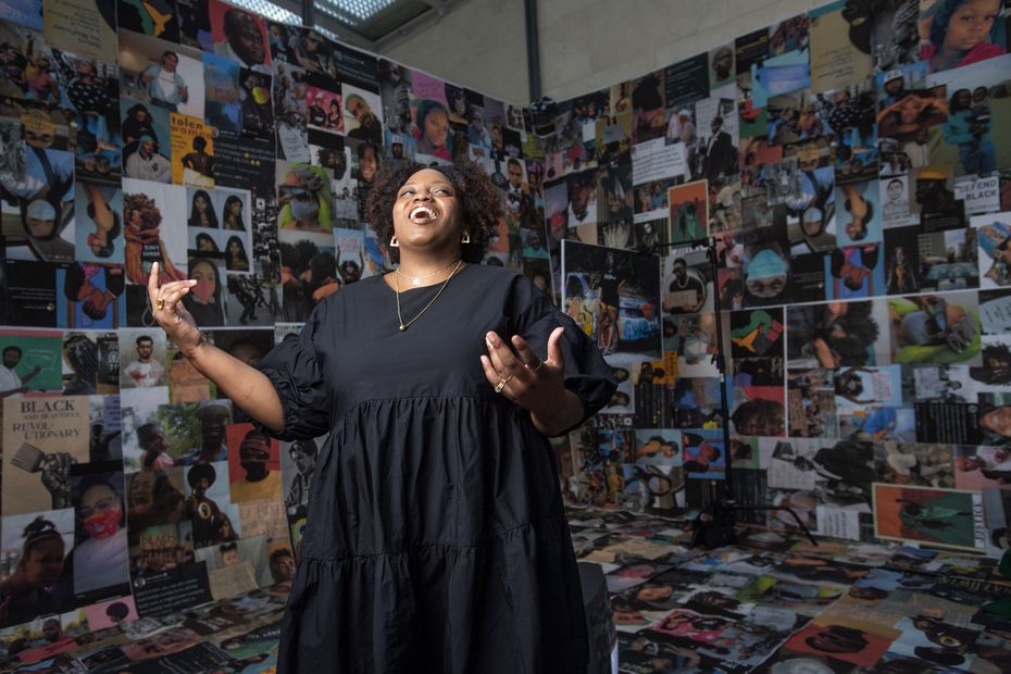 """Dallas artist Ciara Elle Bryant poses for a portrait in her installation """"Server: A Streamed Revolution"""" Tuesday, August 11, 2020 at The Nasher Sculpture Center in Dallas. The piece, which was inspired by Bryant's response to the Black Lives Matter movement, is installed just inside the glass front doors so that it can be viewed from the sidewalk while the center is closed due to the coronavirus."""