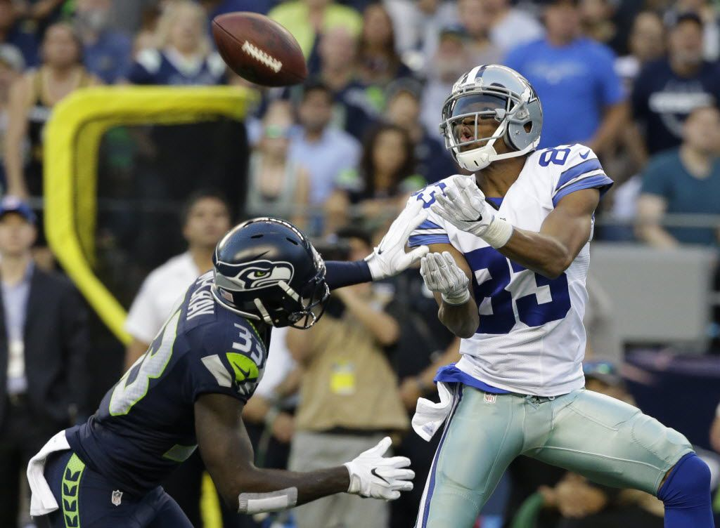 Seattle Seahawks strong safety Kelcie McCray, left, breaks up a pass intended for Dallas Cowboys wide receiver Terrance Williams during the first half of a preseason NFL football game, Thursday, Aug. 25, 2016, in Seattle. (AP Photo/Elaine Thompson)