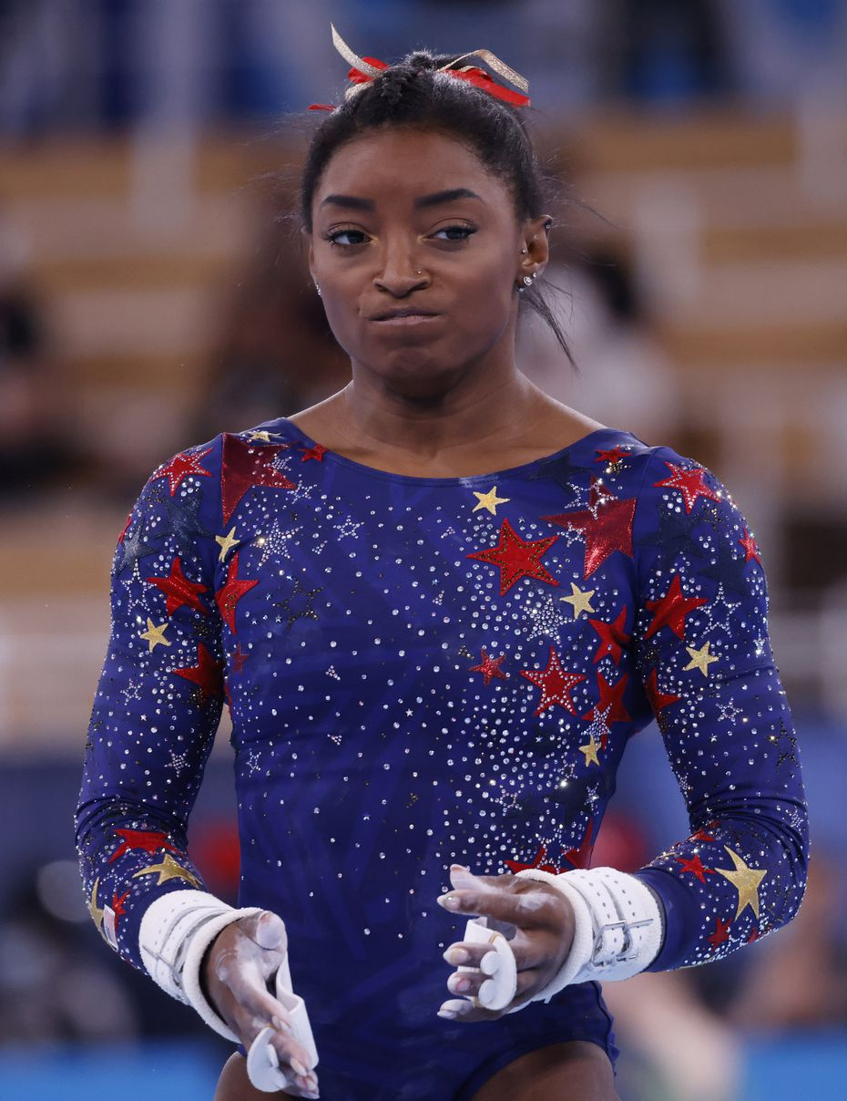 USA's Simone Biles before competing on the uneven bars in a women's gymnastics event during the postponed 2020 Tokyo Olympics at Ariake Gymnastics Centre on Sunday, July 25, 2021, in Tokyo, Japan. (Vernon Bryant/The Dallas Morning News)