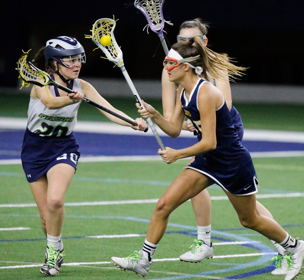 Highland Park's P.J. Van den Branden (19) sprints toward the goal as Frisco's Reghan Schmelzer (20) defends during the first half as Highland Park played the Frisco Fury as part of the Patriot Cup lacrosse tournament at The Ford Center at The Star in Frisco on Saturday, February 18, 2017. (Stewart F. House/Special Contributor)