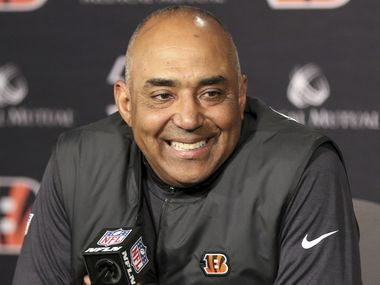 FILE - In this Sunday, Dec. 16, 2018 file photo, Cincinnati Bengals head coach Marvin Lewis attends a new conference after an NFL football game against the Oakland Raiders in Cincinnati. The Dallas Cowboys are talking to former head coaches Mike McCarthy and Marvin Lewis in the surest sign so far that they are moving on from Jason Garrett. Lewis spent time with the Cowboys on Friday and Saturday, Jan. 4, 2020 one of the people said.