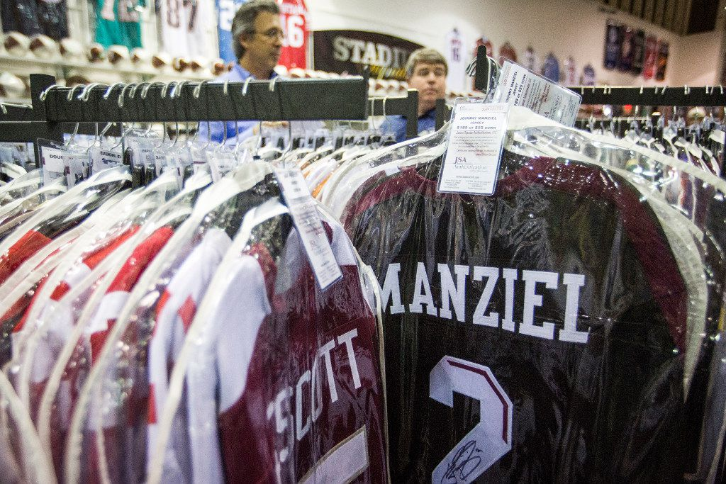 His college jersey on a rack for sale as former Texas A&M and Cleveland Browns quarterback Johnny Manziel  poses for photos and signs autographs at Stadium Signatures at Katy Mills Mall in advance of the Super Bowl LI on Thursday, Feb. 2, 2017, in Katy, Texas. (Smiley N. Pool/The Dallas Morning News)