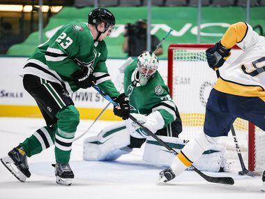 Nashville Predators forward Filip Forsberg (9) shoots the puck past Dallas Stars goaltender Anton Khudobin (35) as defenseman Esa Lindell (23) defends during the second period of an NHL hockey game in Dallas Sunday, March 21, 2021.