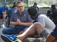 Dallas Mavericks General Manager Donnie Nelson speaks with other members of a small group discussion during a Courageous Conversations meet-up at Victory Plaza outside the American Airlines Center in Dallas on Tuesday, June 9, 2020. Dallas Mavericks CEO Cynt Marshall hosted the event with all team employees, including players and coaches, to discuss systemic racism and disparities facing the African-American community.
