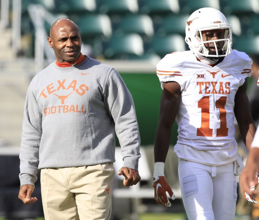 Texas Head Coach Charlie Strong watches his players during the warm-up before the kick-off against Baylor at McLane Stadium in Waco, Texas, Saturday, Dec. 5, 2015.