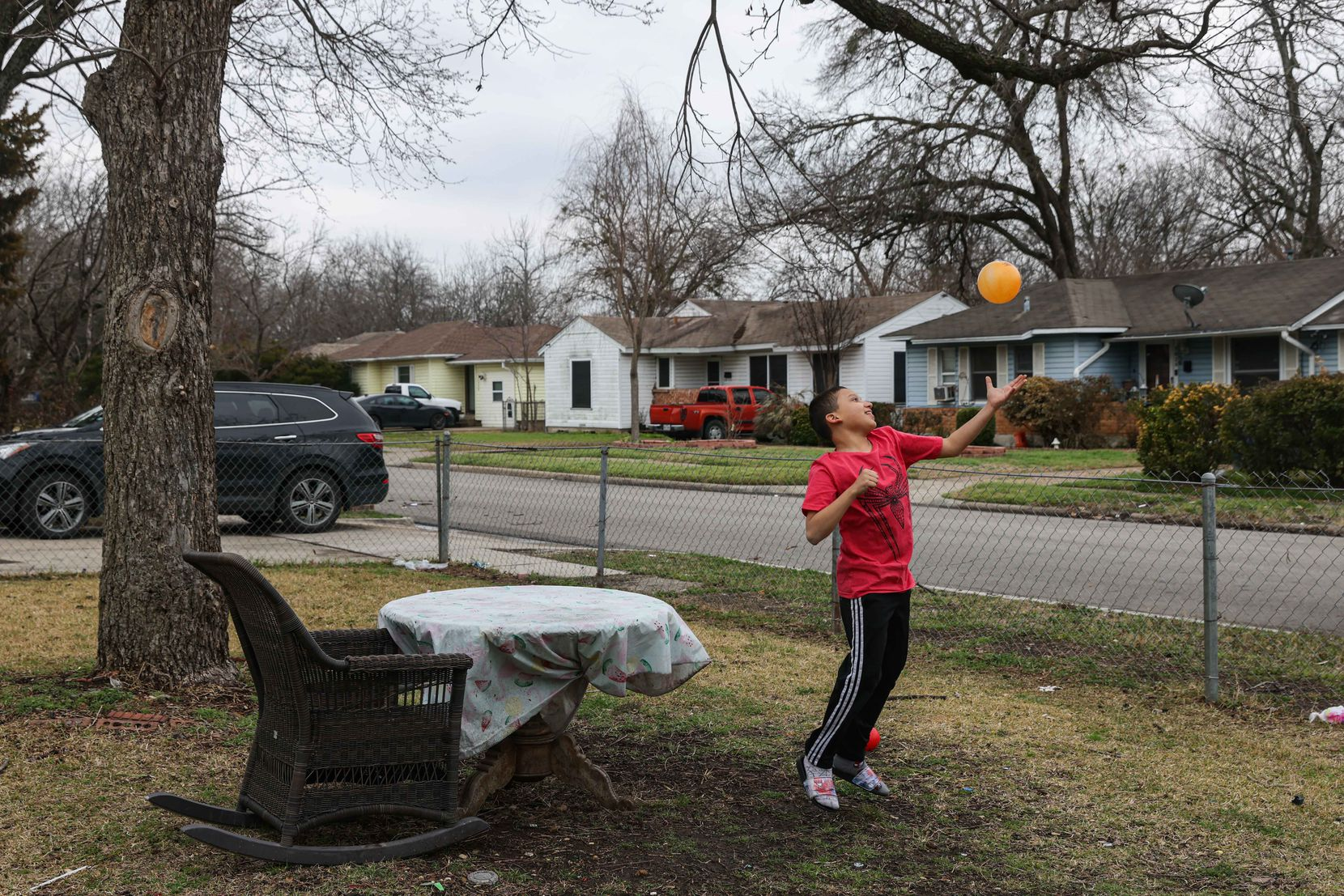 Aaron Hall, 11, who is on the autism spectrum, plays with a plastic ball at his front yard in Dallas on Friday, February 26, 2021. About a week ago, his home lost power for days, bringing the temperature to around 40 degrees Fahrenheit inside after the winter storm hit Texas.